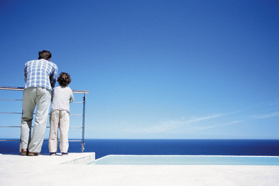 Father and Son Enjoying View of Sea